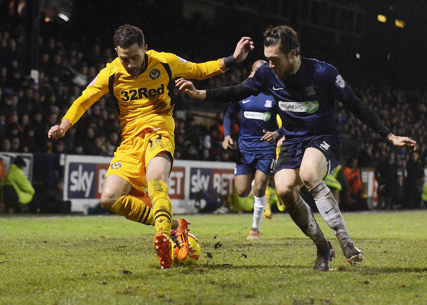 Newport County's Robbie Willmott under pressure from Southend United's Ben Coker<br /> <br /> Photo by Kevin Barnes/CameraSport<br /> <br /> Football - The Football League Sky Bet League Two - Southend United v Newport County - Friday 31st January 2014 - Roots Hall - Southend<br /> <br /> &copy; CameraSport - 43 Linden Ave. Countesthorpe. Leicester. England. LE8 5PG - Tel: +44 (0) 116 277 4147 - admin@camerasport.com - www.camerasport.com