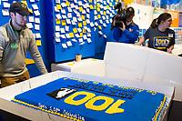 NWA Democrat-Gazette/CHARLIE KAIJO Brandon Eddins of Bentonville (left) unveils the centennial cake, Thursday, March 29, 2018 at The Walmart Museum at Bentonville Square in Bentonville. <br />