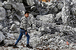 A Palestinian boy walks on the rubble of two under-construction Palestinian residential buildings after they were demolished by Israeli bulldozers in the West Bank town of Biet Jala, near Bethlehem January 29, 2018. Photo by Wisam Hashlamoun