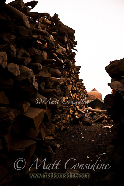 Over 500 bodies are burnt every day on the ghats, requiring many tons of wood.<br /> (Photo by Matt Considine - Images of Asia Collection)