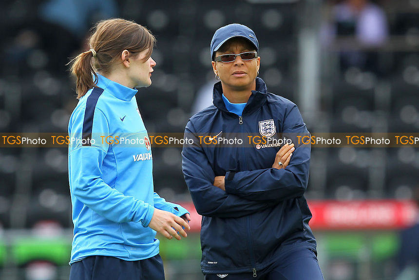 England manager Hope Powell (R) - England Women vs Japan Women - Friendly Football International at the Pirelli Stadium, Burton Albion FC - 26/06/13 - MANDATORY CREDIT: Gavin Ellis/TGSPHOTO - Self billing applies where appropriate - 0845 094 6026 - contact@tgsphoto.co.uk - NO UNPAID USE