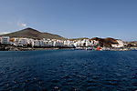 Puerto de La Restingo, Resort and fishing port, with volcanic cone in the background.