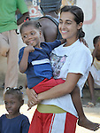 Eline Medjune, 5, a girl in an orphanage in Leogane, Haiti, who survived the January 12 earthquake, gets special attention from Elena Bargo, a Spanish woman who lives in New York and who is helping care for the children here as a volunteer with the Dominican-Haitian Women's Movement (MUDHA).