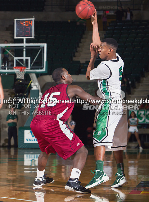 North Texas Mean Green guard Chris Jones (5) and Troy Trojans guard Daronte Clark (15) in action during the game between the Troy Trojans and the University of North Texas Mean Green at the North Texas Coliseum,the Super Pit, in Denton, Texas. UNT defeats Troy 87 to 65.....