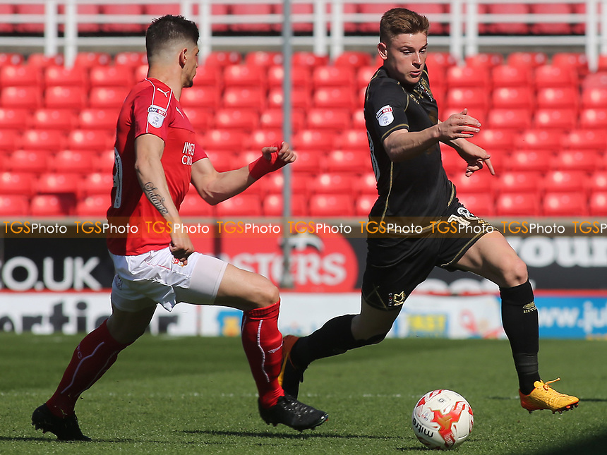 Harvey Barnes of MK Dons takes on the Swindon defence during Swindon Town vs MK Dons, Sky Bet EFL League 1 Football at the County Ground on 8th April 2017