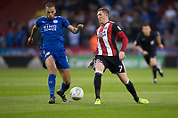 Islam Slimani of Leicester City battles with John Lundstram of Sheffield United during the Carabao Cup match between Sheffield United and Leicester City at Bramall Lane, Sheffield, England on 22 August 2017. Photo by James Williamson / PRiME Media Images.