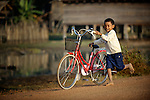 A boy and his bicycle in the Cambodian village of O Kroich. The people of this village are from the Kouy indigenous group.