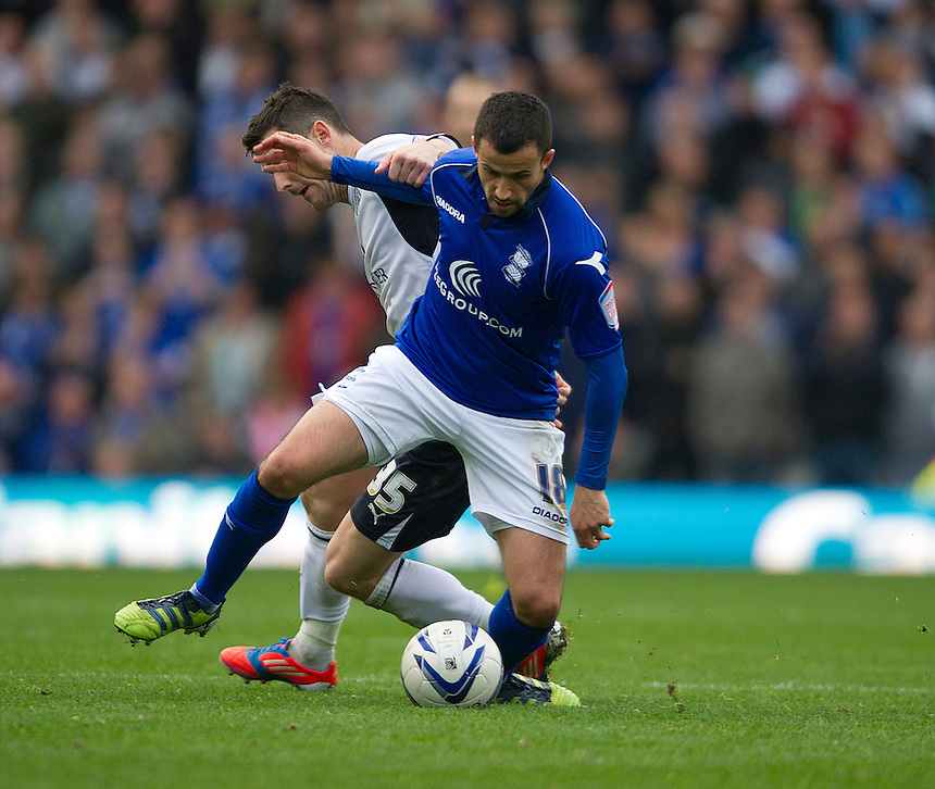 Birmingham City's Keith Fahey shields the ball from Leicester City's David Nugent ..Football - npower Football League Championship - Birmingham City v Leicester City - Saturday 20th October 2012 - St Andrews - Birmingham..
