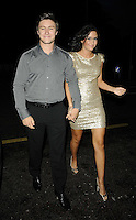Tony Discipline & Jacqueline Jossa.attended the Kensington Club new boutique nightclub launch party, The Kensington Club, High Street Kensington, London, England,.20th July 2012..full length grey gray shirt gold dress black belt trousers  holding hands sequined sequin .CAP/CAN.©Can Nguyen/Capital Pictures.
