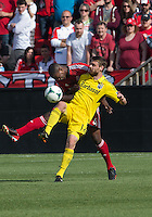 18 May 2013: Columbus Crew midfielder/forward Eddie Gaven #12 and Toronto FC defender Doneil Henry #4 in action during the first half in an MLS game between the Columbus Crew and Toronto FC at BMO Field in Toronto, Ontario Canada....