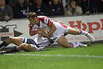 Tommy Bowe dives over to score his second try of the match for Ulster despite the efforts of Blues wing Tom James to stop him..RaboDirect Pro12.Cardiff Blues v Ulster Rugby.Cardiff Arms Park.28.09.12.©Steve Pope