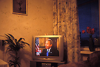 BREST, BELARUS - MAY 5: President Bush is seen on a TV in a home on May 5, 2004 in Brest, Belarus. For years, Belarus was frozen in its communist past. Now the radical change that has swept the former Soviet Union -- from Georgia's 2003 popular uprising to Ukraine's orange revolution last winter to the recent meltdown in Kyrgyzstan -- is catching up with President Alexander Lukashenko, a dictator whose regime has been described as Stalinism minus the Gulag. The images here capture a country and a people inexorably moving toward revolution: Student activists organizing illegally, democratic reformers meeting in rusting warehouses, protesters holding pictures of 'enemies of the state' murdered by the security services. Just beneath the apparent ordinariness and staidness of this post-Soviet republic, which is barely distinguishable from its former Soviet self, is a deep and powerful anger and a yearning for a new politics and a new possibility. That is the crux of Belarus today -- anger and yearning held together by the glimmer of a hope that tomorrow the regime may tumble. (Photo by Landon Nordeman)