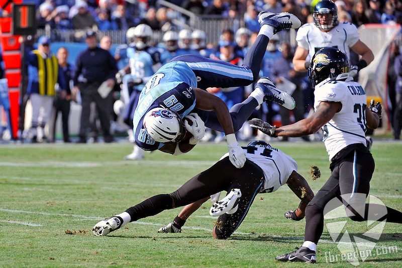 in the first quarter of an NFL football game on Saturday, Dec. 24, 2011, in Nashville, Tenn. (AP Photo/Frederick Breedon)