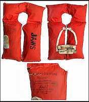 BNPS.co.uk (01202 558833)<br /> Pic: NateDSaunders/BNPS<br /> <br /> ***Please use full byline***<br /> <br /> Actor Richard Dreyfuss' life jacket. <br /> <br /> Rare behind-the-scenes photographs taken on the set of the cult movie 'Jaws' has surfaced after 40 years.<br /> <br /> The 75 pictures include ones of star Roy Scheider, who played shark-hunting police chief Brody in the classic 1975 film, and director Steven Spielberg.<br /> <br /> There are several snaps of the giant mechanical rubber shark that wreaked terror on the fictional seaside resort of Amity.<br /> <br /> It is depicted being hoisted in the air and moved into position as well as sat in a dry dock during a break in the filming.