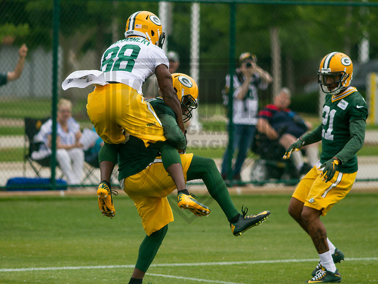 GREEN BAY - June 2015: Green Bay Packers cornerback LaDarius Gunter (36) intercepts a pass as he's tackled by wide receiver Ty Montgomery (88) during a minicamp practice on June 18th, 2015 at Clarke Hinkle Field in Green Bay, Wisconsin. (Brad Krause/Krause Sports Photography)