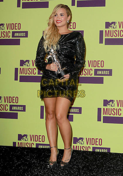 Demi Lovato.2012 MTV Video Music Awards held at Staples Center, Los Angeles, California, USA..September 6th, 2012.full length black sheer dress sequins sequined trophy winner  .CAP/ADM/KB.©Kevan Brooks/AdMedia/Capital Pictures.