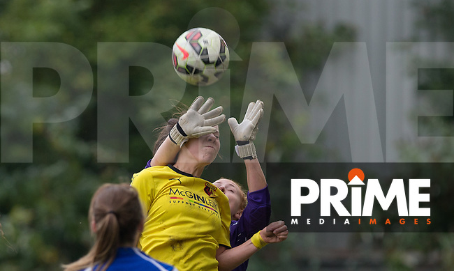 Goalkeeper Sophie Harris of London Bees beats Ellie Mason of Watford Ladies to the ball during the final FAWSL2 match of the 2015 season between Watford Ladies and London Bees at Berkhamsted FC, Berkhamstead, England on 18 October 2015. Photo by Andy Rowland.