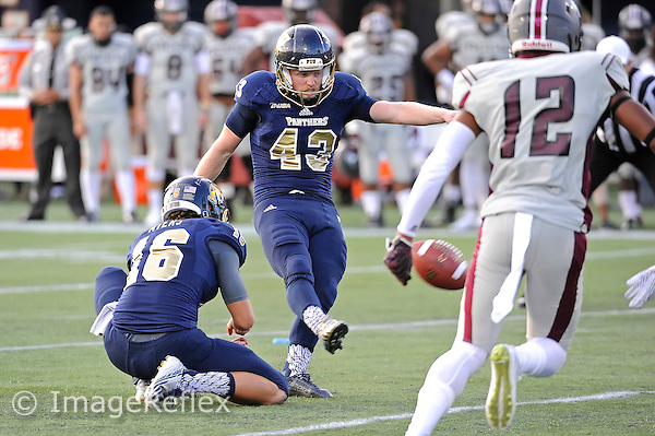 19 September 2015:  FIU kicker/punter Austin Taylor (43) kicks a field goal in the first quarter as the FIU Golden Panthers defeated the North Carolina Central University Eagles, 39-14, at FIU Stadium in Miami, Florida.