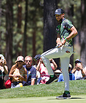 Steph Curry reacts after singing a put during the ACC Golf Tournament at Edgewood Tahoe Golf Course in South Lake Tahoe on Sunday, July 14, 2019.
