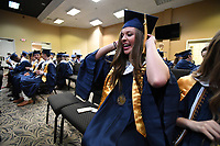 NWA Democrat-Gazette/J.T. WAMPLER Harper Whaley adjusts her tassel Thursday May 18, 2017 before commencement ceremonies for Shiloh Christian School in Springdale. The school graduated 71 seniors.