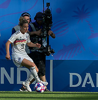 GRENOBLE, FRANCE - JUNE 22: Svenja Huth #9 of the German National Team brings the ball forward during a game between Nigeria and Germany at Stade des Alpes on June 22, 2019 in Grenoble, France.
