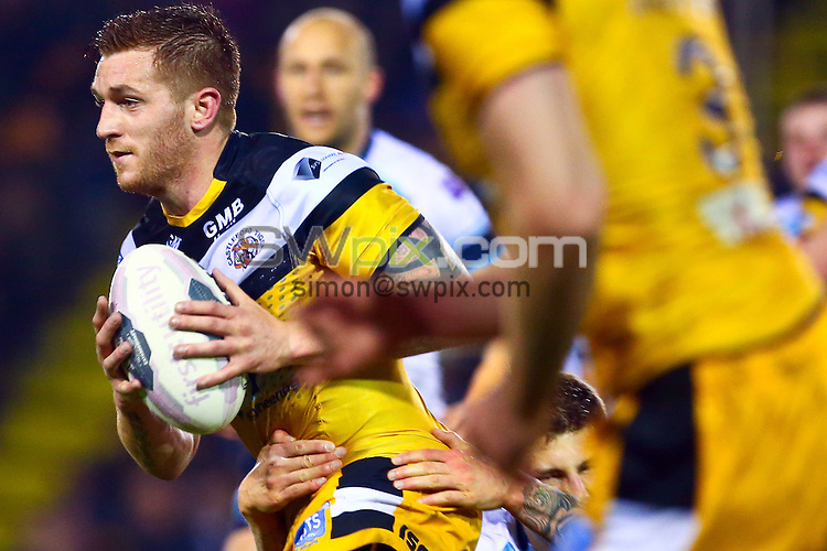 Picture by Alex Whitehead/SWpix.com - 08/05/2014 - Rugby League - First Utility Super League - Castleford Tigers v Leeds Rhinos - the Mend A Hose Jungle, Castleford, England - Castleford's Marc Sneyd is tackled by Leeds' Liam Sutcliffe.
