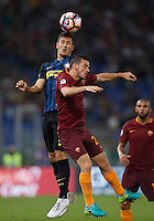 Calcio, Serie A: Roma vs Inter. Roma, stadio Olimpico, 2 ottobre 2016.<br /> FC Inter&rsquo;s Stevan Jovetic, left, and Roma&rsquo;s Alessandro Florenzi jump for the ball during the Italian Serie A football match between Roma and FC Inter at Rome's Olympic stadium, 2 October 2016.<br /> UPDATE IMAGES PRESS/Isabella Bonotto