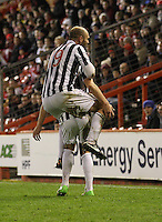 Sam Parkin climbs on Kenny McLean celebrating in the Aberdeen v St Mirren Scottish Communities League Cup match played at Pittodrie Stadium, Aberdeen on 30.10.12.