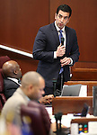 Nevada Sen. Ruben Kihuen, D-Las Vegas, works on the Senate floor at the Legislative Building in Carson City, Nev., on Monday, April 20, 2015. <br /> Photo by Cathleen Allison