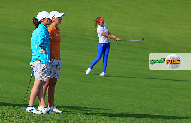 Leona Maguire and Charlotte Thomas watching Hannah O'Sullivan on the 13th during the Saturday Afternoon Fourballs of the 2016 Curtis Cup at Dun Laoghaire Golf Club on Saturday 11th June 2016.<br /> Picture:  Golffile | Thos Caffrey