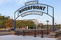 An arched welcome sign marks the entrance to Riverfront Park in Montgomery, Alabama.