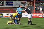 Dundee 0 Greenock Morton 1, 27/08/2011. Dens Park, Scottish League First Division. Dundee's centre forward Graham Bayne remonstrates with referee Frank McDermott during a Scottish League First Division match at Dens Park stadium against visitors Greenock Morton. The visitors won by one goal to nil watched by a crowd of 4,096. Dundee  stadium was situated on the same street as their city rival Dundee United, whose Tannadice Park ground was situated a few hundred yards away.