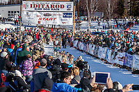 Michelle Phillips leaves the start line amongst a crow of spectaors during the Restart of the 2016 Iditarod in Willow, Alaska.  March 06, 2016.