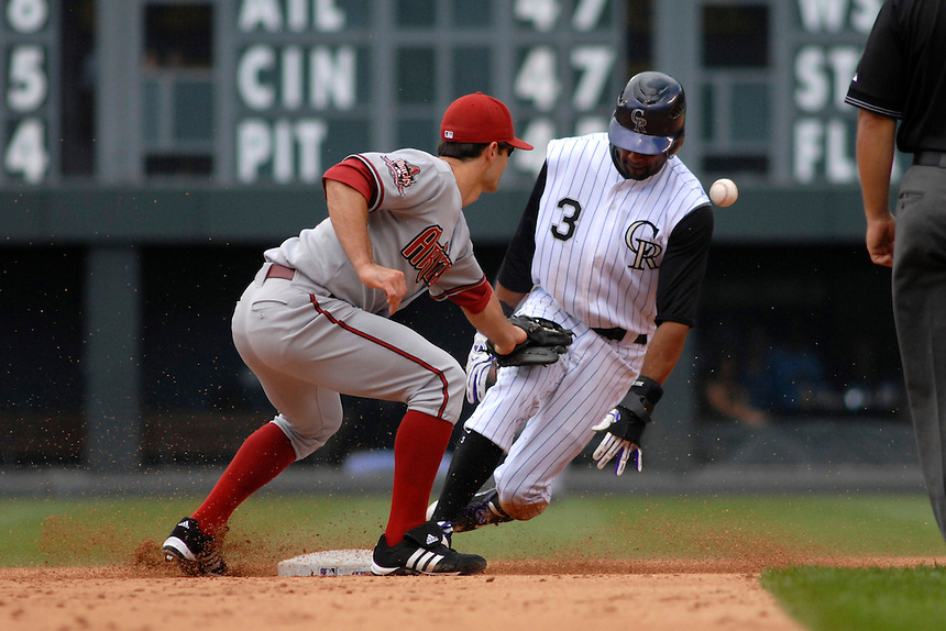 14 August 08: DBacks 2nd baseman Chris Burke loses control of the ball attempting to apply a tag to Willy Taveras, who stole his 53rd base of the year. The steal tied the Rockies club record for most stolen bases in one season. The Arizona Diamondbacks defeated the Colorado Rockies 6-2 at Coors Field in Denver, Colorado.