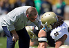 April 21, 2012:  Notre Dame Fighting Irish head coach Brian Kelly  talks with defensive end Kona Schwenke (96) during pregame of the Notre Dame Blue-Gold Spring game at Notre Dame Stadium in South Bend, Indiana.  The Defense topped the Offense by a score of 42-31.