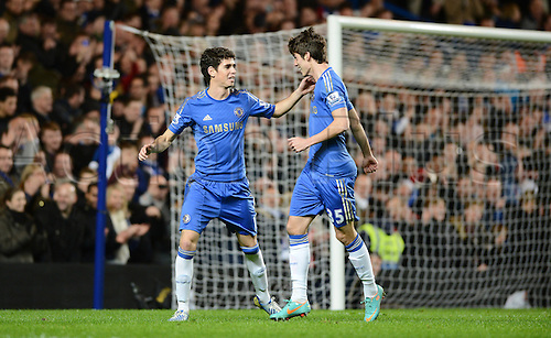 23.12.2012 London, England. Oscar of Chelsea celebrates scoring with Lucas Piazon of Chelsea during the Premier League game between Chelsea and Aston Villa at Stamford Bridge...