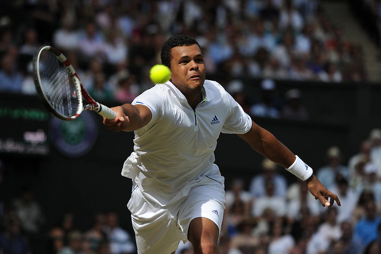 Jo-Wilfried Tsonga (FRA) in action today during his victory over Roger Federer (SUI in todays Gentlemen's Singles Quarterfinal match - Jo-Wilfried Tsonga (FRA)[12] def Roger Federer (SUI)[3] 3-6 6-7(3) 6-4 6-4 6-4...
