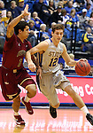 BROOKINGS, SD - FEBRUARY 8:  Brayden Carlson #12 from South Dakota State drives against Khufu Najee #1 from IUPUI in the first half of their game Saturday afternoon at Frost Arena in Brookings. (Photo by Dave Eggen/Inertia)