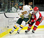 12 December 2009: University of Vermont Catamount forward Jack Downing, a Junior from New Canaan, CT, battles for possession against St. Lawrence University Saints' defenseman Jeff Caister, a Senior from Mississauga, Ontario, at Gutterson Fieldhouse in Burlington, Vermont. The Catamounts shut out their former ECAC rival Saints 3-0. Mandatory Credit: Ed Wolfstein Photo
