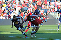 Chicago defender Jalil Anibaba (6) tries for the diving header in front of New York defender Brandon Barklage (25) and midfielder Jan Gunnar Solli (center, behind).  The Chicago Fire defeated the New York Red Bulls 3-1 at Toyota Park in Bridgeview, IL on June 17, 2012.
