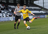 Liam Dick clears under pressure from Kieran Doran in the St Mirren v Falkirk Clydesdale Bank Scottish Premier League Under 20 match played at St Mirren Park, Paisley on 30.4.13.