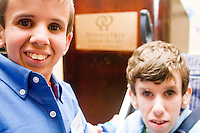 Colt Stillwell, left, and Erik Kjorling at the Share and Care Network's annual retreat held at the Doubletree Guest Suites Hotel in Boston on May 20, 2006. <br /> <br /> The Share and Care Network was created in 1981 by Pat Cahill when her son Scott was diagnosed with Cockayne Syndrome.  A rare form of dwarfism, Cockayne Syndrome is a genetically determined condition whose symptoms include microcephaly, mental retardation, progressive blindness, progressive hearing loss, premature aging, and a shortened lifespan averaging 18 years.  Those afflicted have distinctive facial features, including sunken eyes, pinched faces, and protruding jaws as well as distinctive gregarious, affectionate personalities.<br /> <br /> Because of the rarity of the condition (1/1,000 live births) and its late onset (characteristics usually begin to appear only after one year), many families and physicians are often baffled by children whose health begins to deteriorate after normal development.  It was partly with this in mind that the Share and Care Network was formed, to promote awareness of this disease as well as to provide a support network for those families affected.  In 1998 it began organizing an annual retreat, which has grown from three families in its inaugural year to more than 30 today.  Although the retreat takes place in the United States, families from as far as Japan arrive for this one weekend out of the year to share information and to support one another.