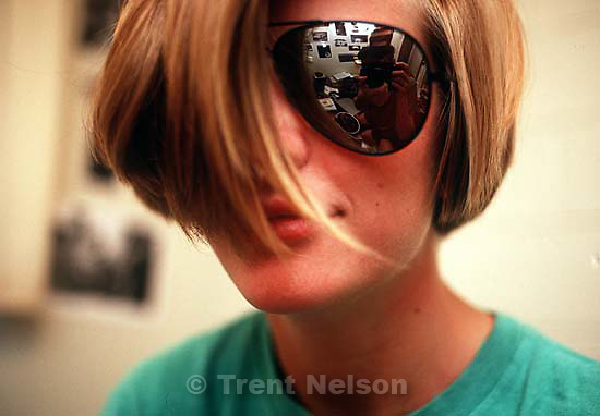 Laura Nelson with sunglasses (Trent Nelson with camera reflected in lens)<br />