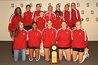 18 November 2005: The team poses with an auction winner during Stanford's 3-2 win over California in the Big Spike at Maples Pavilion in Stanford, CA.