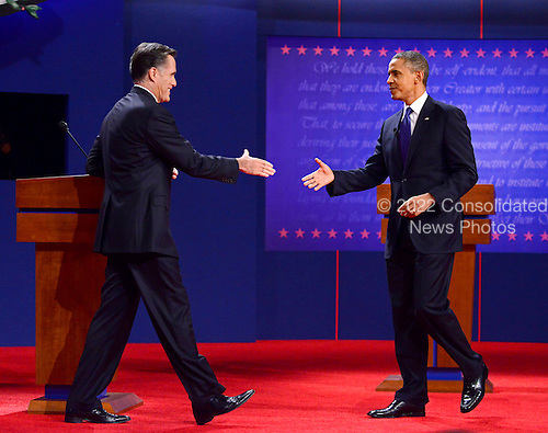 United States President Barack Obama, the Democratic Party nominee for President, and former Massachusetts Governor Mitt Romney, the Republican Party nominee for President, go to shake hands following their face-off in the first Presidential Debate of the 2012 General Election at the University of Denver in Denver, Colorado on Tuesday, October 2, 2012..Credit: Ron Sachs / CNP.(RESTRICTION: NO New York or New Jersey Newspapers or newspapers within a 75 mile radius of New York City)