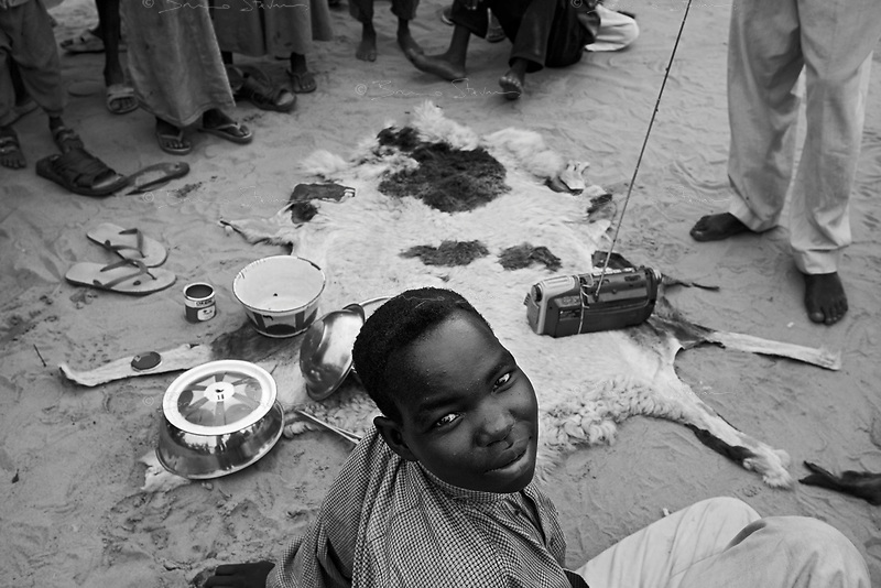 En Geneina, West Darfur, August 10, 2004.IDP's listening to the local radio station in Sultan House IDP camp.