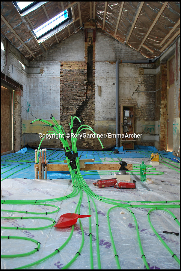 BNPS.co.uk (01202 558833)Pic: RoryGardiner/EmmaArcher/BNPS<br /> <br /> Underfloor heating...<br /> <br /> Council Depot transformed into a million pound minimalist masterpiece.<br /> <br /> An architect has transformed a former council depot in Hackney into a stunning £1.35million property.<br /> <br /> James Davies, 34, has spent two years transforming the historic, dilapidated former school building in Stoke Newington, north east London, into a modern, stylish two-storey, two-bedroom house, living on site during the conversion. <br /> <br /> The renovation of the site at Defoe Road, which is yards from the high street, cost a hefty £350,000.<br /> <br /> But the investment has paid off handsomely as the property, which has its own inner courtyard, has already been snapped up for £1.35m.