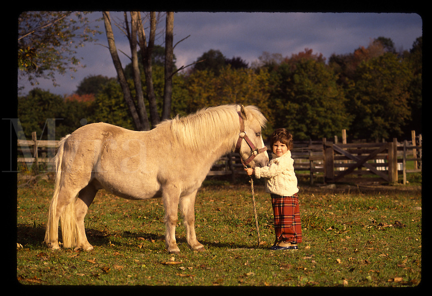 Young girl with pony.