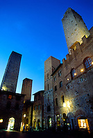 The towers of the medieval hilltop town of San Gimignano at twilight, Tuscany, Italy