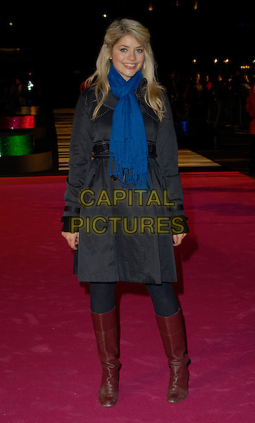 "HOLLY WILLOUGHBY.Attends the UK Premiere of ""Music & Lyrics"",.Odeon Leicester Square, .London, England, February 5th 2006..full length blue scarf coat brown knee high boots.CAP/CAN.©Can Nguyen/Capital Pictures"
